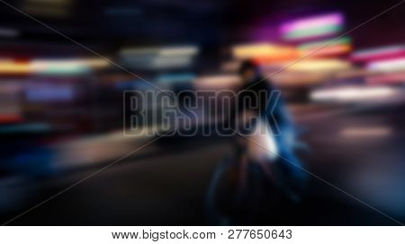 Motion Blurred Image Of Riding Cyclist. Riding Cyclists. Bicyclistsin In City, Night, Abstract.
