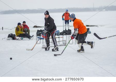 Dnipro, Ukraine - January 28, 2018: Group Of Different Aged People Playing Hokey And Resting On An I