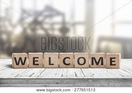 Welcome Sign On A Table In A Lobby With A Bright Room In The Background