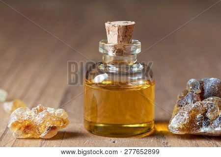 A Bottle Of Frankincense Essential Oil And Resin