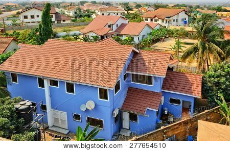 Residential Area In West Africa. Top View On Family Houses, Yards With Gardens, Surrounded By Fences