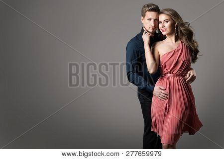 Fashion Couple, Young Beautiful Woman In Summer Dress And Elegant Man Studio Beauty Portrait