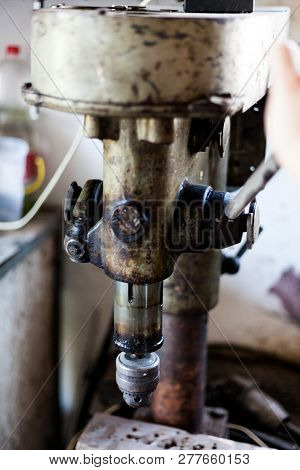 Metal Industry Stand With Drill Machine. Home Workshop With Hard Tools On The Metal Stand. Old Rusty