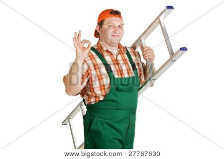 Worker In Overalls And A Baseball Cap