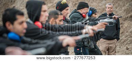Shooting Range. Instructor Avi Nardia Teaches Large Group Of Students