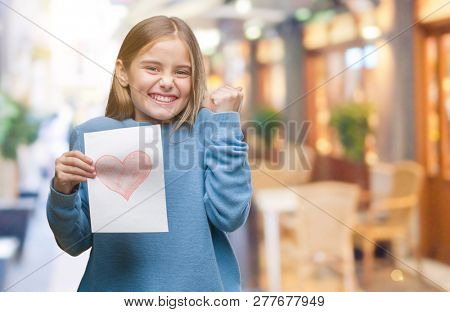 Young beautiful girl giving mother father day card with red heart over isolated background screaming proud and celebrating victory and success very excited, cheering emotion