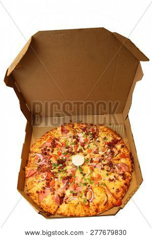 Pizza. Hawaiian Pizza in cardboard deliver box. Pineapple Pizza. Pizza with pineapple, ham, onions, cheese, tomatoes, bacon, and sauce.  Isolated on white Room for text