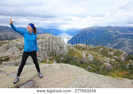 Young Beautiful Hiker Taking Herself A Selfie On Her Way To The Summit Of The Pulpit Rock (preikesto