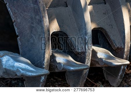 Backhoe Scoop Shovel Bucket Abstract With Newly Welded Teeth