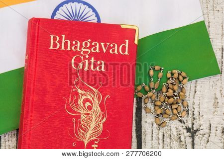 Maski,karnataka,india - December 29,2018 : Holy Bhagavad Gita On Indian Flag With Wooden Textured Bc