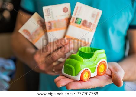 Business, Finance, Savings, Banking Or Car Loan Concept.miniature Car Model In Hand, Money And Savin