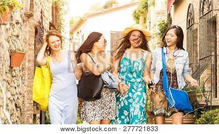 Multiracial Millennial Girlfriends Walking And Talking In Old Town Tour - Happy Girls Having Fun Aro