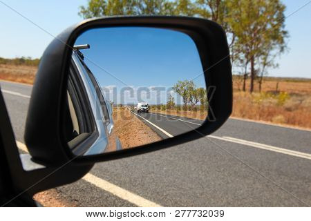 View In The Side Mirror On The Carnarvon Highway In Central Queensland Australia. 4wd Vehicle Towing