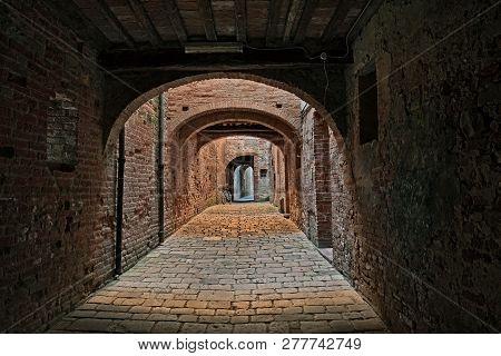 Buonconvento, Siena, Tuscany, Italy : The Picturesque Covered Street Via Oscura, A Narrow Dark Alley