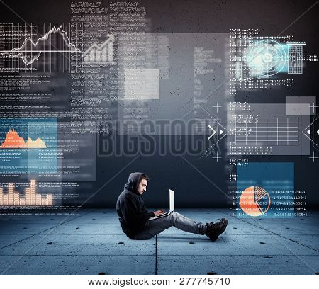 Man Working On Laptop And Futuristic Graphs Codes Interface.