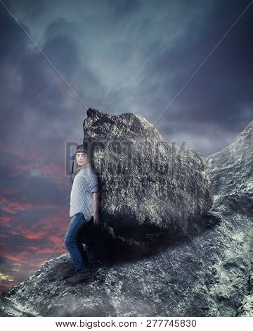 Man Holding A Big Stone Falling Downward.