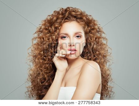 Perfect woman with long healthy curly hair. Redhead girl, haircare concept poster