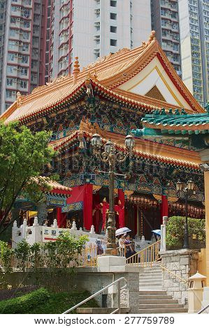 Hong Kong, China - September 14, 2012: Sik Sik Yuen Wong Tai Sin Temple With The Modern Residential
