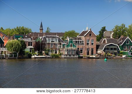 Zaandijk, Netherlands. Quaint Dutch Village View With Zaan River.