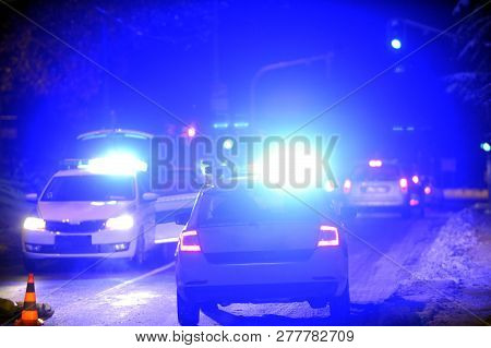 Patrol Police Car With Blue Emergency Lights In Traffic Control Activity