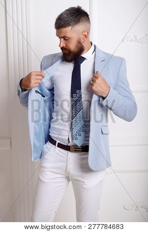 Sale, Fashion, Retail, Business Style And People Concept - Seriously Hipster Man With Beard At Cloth