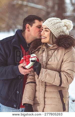Gift Hearts - Man Gives A Box With A Gift To His Loving Girlfriend For Valentines