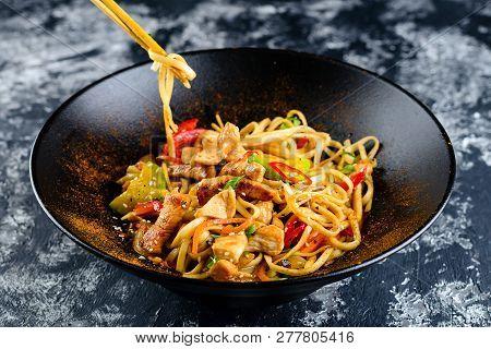 Udon Noodles With Chopsticks Of Japanese Food, Kudzued Udon, Udon Noodle Hot Pot. Wok.