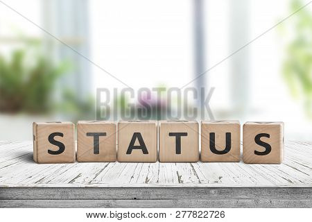 Status Sign Made Of Wood On A Table In A Bright Room