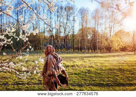 Happy Woman Relaxing In Spring Garden. Senior Woman Walking In Field. Lady Enjoying Life