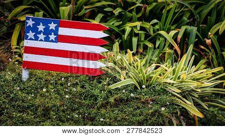 A Wooden American Flag Sits In A Yard In Coronado, Ca.