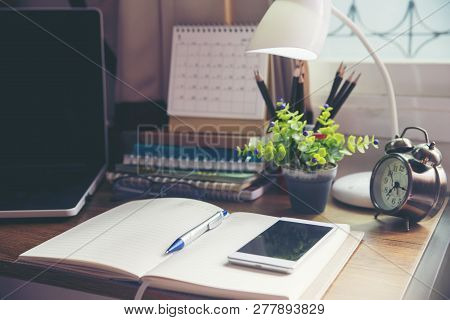 Desk For Student,study For Exam.wooden Table With Desktop Laptop,notebook,book,pencils,diary,notepad