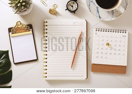 Flat Lay Desk With Notebook, Calendar, Clipboard And Pen, Golden Accessories, Warm Tone