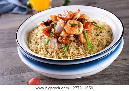 Seafood Fried Rice In A White Pot