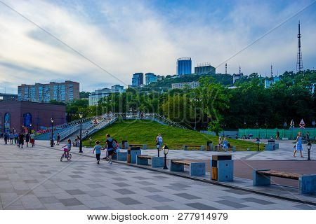 Vladivostok, Russia-august 11, 2018: Tsarevich Embankment With People Resting In The Evening. Vladiv