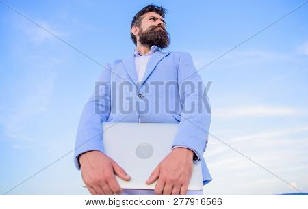 Man Bearded Hipster Manager Hold Laptop Blue Sky Background. Guy Formal Suit Modern Technology Manag