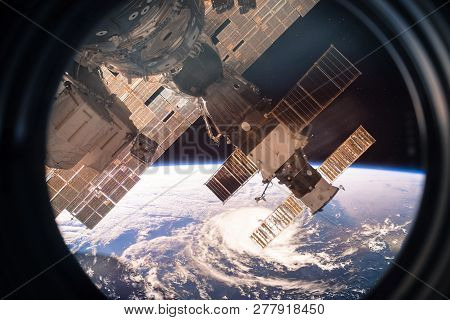 Collage Image With Planet Earth From The Outer Space From The Iss Window. Huge Hurricane. Elements O