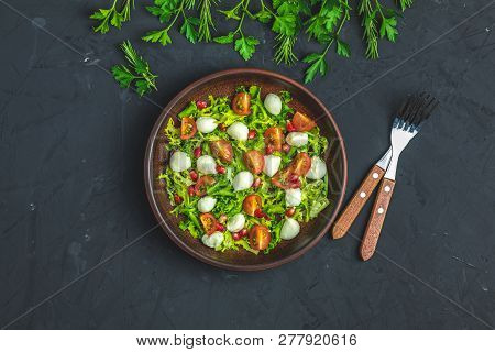 Fresh Cherry Tomato, Mozzarella Salad With Green Lettuce Mix Served On A Brown Ceramic Plate, Health