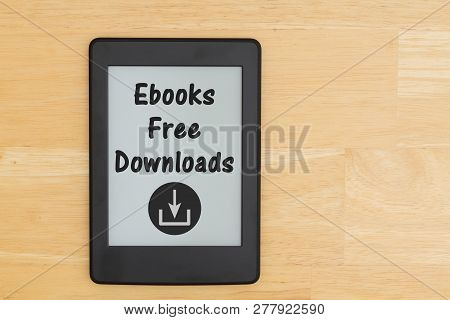 An e-reader on a desk  with text Ebooks Free Downloads and a download icon poster