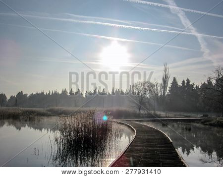 Background With Wood Path Walkway At Lake Shore On A Calm Tranquil Winter Morning. Frost Hoar Wooden
