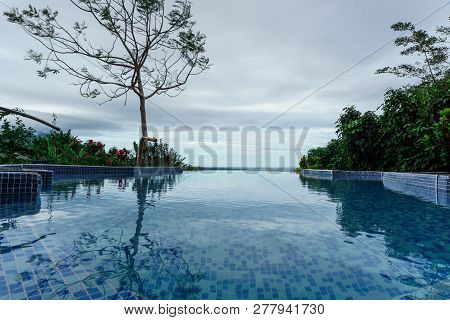 Beautiful Swimming Pool At The Edge Of The Beach In The Middle Of Nature