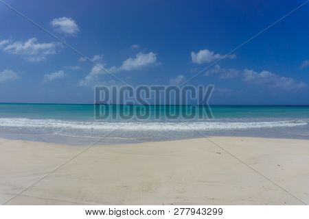 Beautiful View Of A Morning On The Shore Of The Beach In Costa Rica With A Clear Sky And Calm Waters
