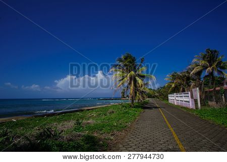 Landscape View With Road Next To The Beach