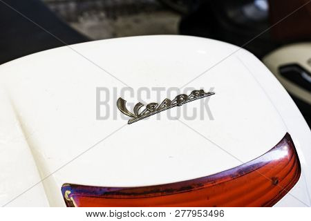 Verona, Italy - December 09, 2018: Detail Of White Vespa Scooter. Vespa Is An Italian Brand Of Scoot