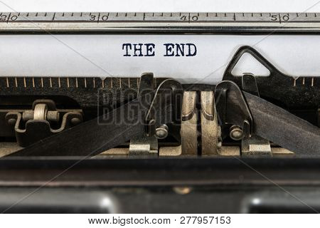 A vintage typewriter with the text the end