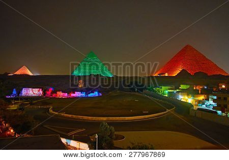 The Light Show In Giza Necropolis - Bright Lights On Ancient Pyramids And Great Sphinx Make This Pla