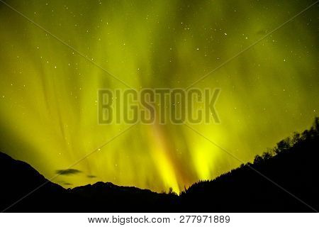 Magical Aurora Borealis On Alaskan Night Sky