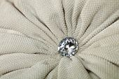 Close up diamond shaped crystal strass or rhinestone decoration on grey beige furniture textile upholstery poster