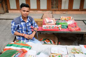 New Delhi, Aug 15, 2018 - A Boy Selling Flags, Braclets, Badges And Other Items On The Occasion Of T