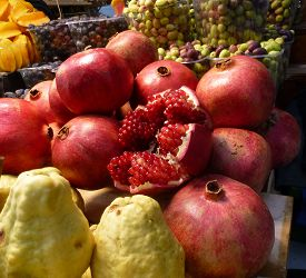 Many Different Fruits - Pomegranates, Pears, Grapes -on The Table