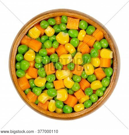 Green Peas, Corn And Carrot Cubes In Wooden Bowl. Mixed Vegetables. Peas Mixed With  Vegetable Maize
